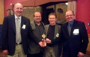 Members of Faith Technologies, Mullins Group, and Stevens Construction proudly accepting the Projects of Distinction award for the 2550 University Avenue Apartments project in Madison, Wis.